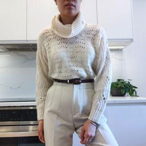 Light knit crochet like sweater